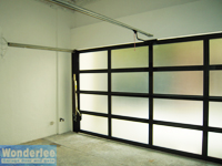 Inside look of garage with 1-piece canopy door, very well lighted