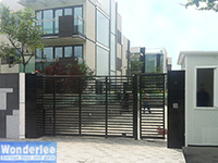 Slide gate with steel frame and wood infill