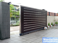 Automatic slide gate, wood with stainless steel trim