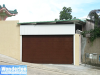 Sectional overhead garage door with wood patterned flush panel